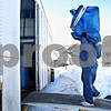 Beck Diefenbach  -  bdiefenbach@daily-chronicle.com<br /> <br /> David Mendez, of Blackhawk Moving, carries a sofa chair into the moving truck full of the Reed family's belongings in Sycamore, Ill., on Tuesday Jan. 20, 2009. The Reed family is moving to Port Richie, Fla.