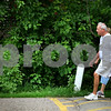 Beck Diefenbach  -  bdiefenbach@daily-chronicle.com<br /> <br /> Chuck and Sharron Reichling, of DeKalb, cross Hopkins Park for their daily walk on Sunday June 21, 2009.