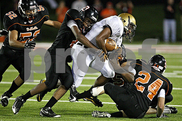 Rob Winner rwinner@daily-chronicle.com<br /> Sycamore's Marckie Hayes tries to break free of DeKalb's defensive players in the first half.<br /> 09/11/2009