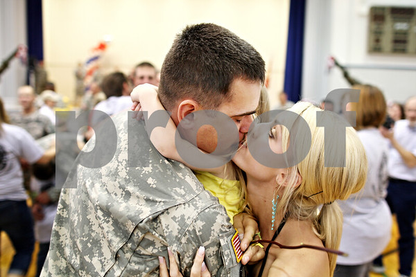 Beck Diefenbach  -  bdiefenbach@daily-chronicle.com<br /> <br /> Sebastian Wolff, of Rockford, kisses his wife Lindsay after returning from a tour in Afghanistan at the Sycamore National Guard Armory in Sycamore, Ill., on Monday June 1, 2009.