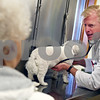 """Beck Diefenbach – bdiefenbach@daily-chronicle.com<br /> <br /> Dr. David Emmert checks the heart rate of Lola, a 3 year old maltese poodle, as her owner, Jean Talbert, of DeKalb, watches at Prairie View Animal Hospital in DeKalb, Ill., on Thursday March 5, 2009. Talbert took Lola in for protruding eye lid called """"cherry eye."""""""