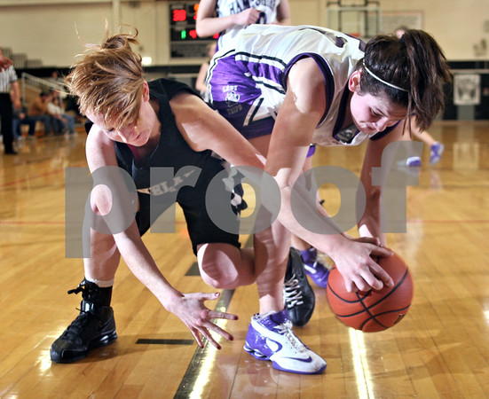 Beck Diefenbach  -  bdiefenbach@daily-chronicle.com<br /> <br /> Kaneland forward Mallory Carlson (21) and Hampshire forward Alex Dumoulin (31) fight for a loose ballduring the third quarter of the Kaneland Regional Semi Final game at Kaneland High School in Maple Park, Ill., on Tuesday Feb. 17, 2009.
