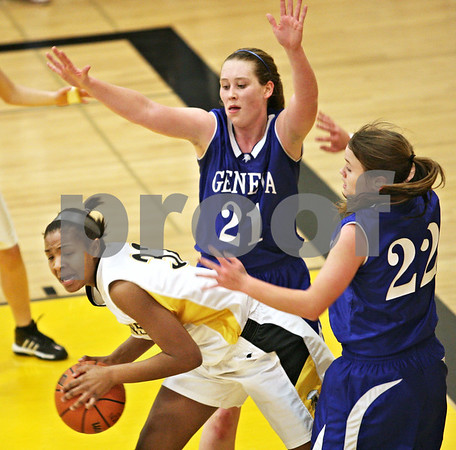 Beck Diefenbach  -  bdiefenbach@daily-chronicle.com<br /> <br /> Geneva forward Sam Dudman (21) covers Sycamore guard Briana Henke (33) as she looks for an open pass during the third quarter of the game at Sycamore High School in Sycamore, Ill., on Tuesday Feb. 3, 2009. Geneva beat Sycamore 57 to 31.