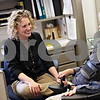 Beck Diefenbach  -  bdiefenbach@daily-chronicle.com<br /> <br /> DeKalb County Ramp manager Tina Vavra, left, shares a laugh with personal assistant coordinator JJ. Wett on Tuesday May 19. 2009, while taking a break from setting up for Ramp's 15 year celebration at their DeKalb, Ill., office.