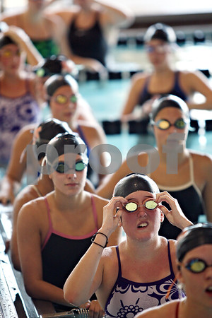 Beck Diefenbach  -  bdiefenbach@daily-chronicle.com<br /> <br /> Senior Carly Primrose, lower right, adjusts her googles between laps during practice at the DeKalb High School swimming pool in DeKalb, ill., on Wednesday Sept. 2, 2009.