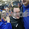Beck Diefenbach – bdiefenbach@daily-chronicle.com<br /> <br /> Hinckley-Big Rock head coach Greg Burks is swarmed by fans after his team beat Dakota High School in the 1A Super Sectional game at Elgin Community College in Elgin, Ill., on Monday Feb. 23, 2009.
