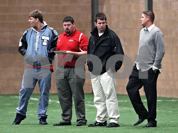 Beck Diefenbach  -  bdiefenbach@daily-chronicle.com<br /> <br /> Recruits watch during Northern Illinois Football practice at the DeKalb Recreation Center in DeKalb, Ill., on Friday Dec. 12, 2009.