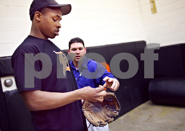Beck Diefenbach  -  bdiefenbach@daily-chronicle.com<br /> <br /> Assistant coach Paul Severino works with pitcher Tommy Scott on his grip during bullpen practice at DeKalb High School in DeKalb, Ill., on Monday April 6, 2009.