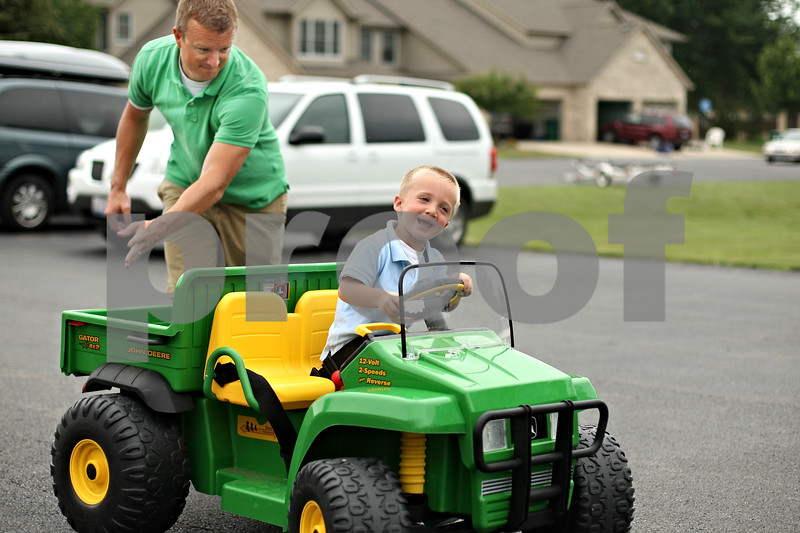 Beck Diefenbach  -  bdiefenbach@daily-chronicle.com<br /> <br /> Connor Wright, 3, gets a push from his father, Jack, while playing outside his family's Sycamore home on Tuesday July 7, 2009. Connor received help from Shriners Hospital to fix his cleft palate and now the his family is hosting a golf tournament to raise money for the organization.