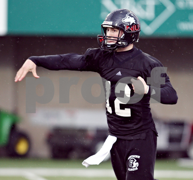 Beck Diefenbach  -  bdiefenbach@daily-chronicle.com<br /> <br /> Northern Illinois' Chandler Harnish (12) during practice at NIU's Huskie Stadium in DeKalb, Ill., on Tuesday March 24, 2009.
