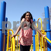 WENDY KEMP/FOR THE DAILY CHRONICLE<br /> Third grade student Mahitha Takkasila plays outside during the after school program at West Elementary in Sycamore on Friday.<br /> 4/24/09 Sycamore