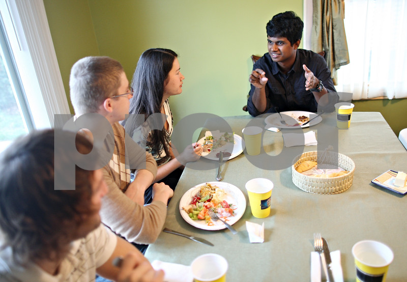 Beck Diefenbach  -  bdiefenbach@daily-chronicle.com<br /> <br /> Momtazul Karim (right), of Bangledesh, talks with a group of students from Ukraine during a Thanksgiving dinner for international students at the Riley's home in Sycamore, Ill., on Thursday Nov. 26, 2009.