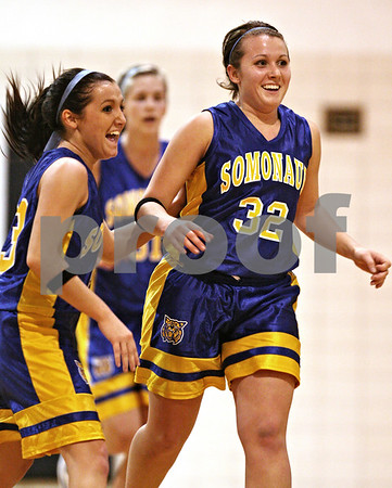 Beck Diefenbach  -  bdiefenbach@daily-chronicle.com<br /> <br /> Somonauk's Hillary Paull (33, left) and her sister Emily (32) celebrate after Emily sank a shot at the buzzer at the half to extend it's lead over Indian Creek at Indian Creek High School in Shabbona, Ill., on Thursday Dec. 10, 2009. Somonauk defeated Indian Creek 49 to 47.