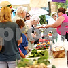 Beck Diefenbach  -  bdiefenbach@daily-chronicle.com<br /> <br /> Customers wait to make their purchases at the farmers market in downtown DeKalb, Ill., on Thursday July 9, 2009.