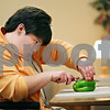 Beck Diefenbach  -  bdiefenbach@daily-chronicle.com<br /> <br /> Emily Lampkin slices a green pepper as she helps to prepare lunch for her class at Life School Transition Program in Sycamore, Ill., on Tuesday Feb. 10, 2009. Lampkin is learning to provide for herself in practice such as cooking a meal.