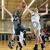 Beck Diefenbach  -  bdiefenbach@daily-chronicle.com<br /> <br /> DeKalb guard Darius McNeal (11) shoots the ball pas the grasp of Kaneland center Dave Dudzinski (55) during the second quarter of the game against Kaneland at Kaneland High School in Maple Park, Ill., on Friday Jan. 23, 2009.