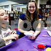 Rob Winner – rwinner@daily-chronicle.com<br /> Nataliya Shvchenko, 8 of DeKalb, laughs with circulation clerk Darcy Tatlock as the two make a holiday cracker filled with confetti at the DeKalb Public Library in DeKalb, Ill. on Thursday December 31, 2009.