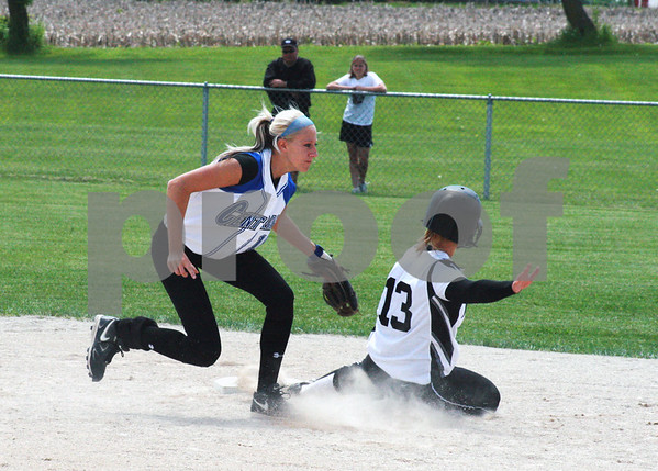 Randi Stella – rstella@daily-chronicle.com<br /> <br /> During the Kaneland against Burlington Central high varsity softball game, Mallory Huml (13) slides to second, guarded by Kayla Oranger (18) in Hampshire, May 30th, 2009.