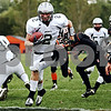 Rob Winner - rwinner@daily-chronicle.com<br /> <br /> Blake Serpa runs into the end zone during the first quarter for his and Kaneland's second touchdown score.<br /> <br /> 10/10/2009