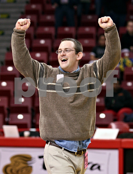 Beck Diefenbach – bdiefenbach@daily-chronicle.com<br /> <br /> Hinckley-Big Rock's head coach Greg Burks celebrates before receiving his medal for defeating Winchester West Central in the Class 1A State Championship at the Redbird Arena in Normal, Ill., on Saturday Feb. 28, 2009.