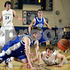Beck Diefenbach – bdiefenbach@daily-chronicle.com<br /> <br /> Central's Shane Larkin (30) and Sycamore's Michael Buckner (5) leap for a loose ball during the first quarter of the regional semi-final game at Central High School in Burlington, Ill., on Monday March 2 , 2009.