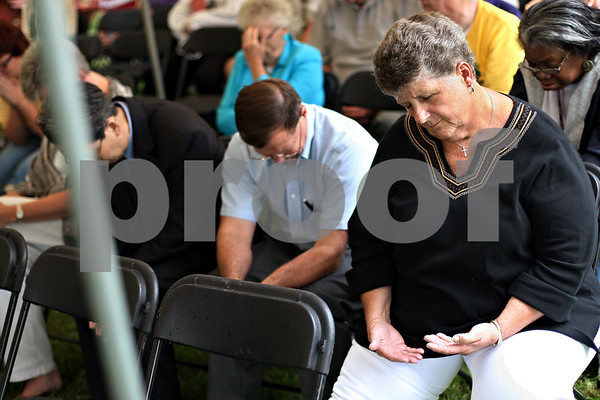 Beck Diefenbach  -  bdiefenbach@daily-chronicle.com<br /> <br /> Charla Antrobus, of Cortland, takes part in a prayer service for the Cortland United Methodist Church in Cortland, Ill., on Wednesday August 26, 2009.