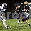 Rob Winner –  rwinner@daily-chronicle.com<br /> Sycamore's CJ Compher goes up the middle after a reception in the first half.<br /> 09/18/2009
