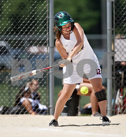 Beck Diefenbach  -  bdiefenbach@daily-chronicle.com<br /> <br /> Kishwaukee Valley Storm's Amber Musich (12) swings the bat during the 18-under game against the St. Charles Comets during Storm Dayz in Sycamore, Ill., on Sunday June 28, 2009.