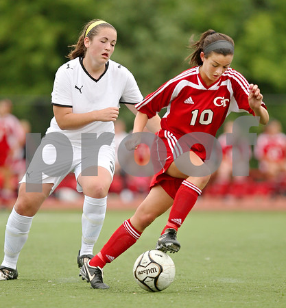 Beck Diefenbach  -  bdiefenbach@daily-chronicle.com<br /> <br /> Sycamore's Brianna Henke (left) tries to keep up with Cathum Glenwood's Ali Traina (right) during the second half of the Class 2A third place tournament game at North Central College in Naperville, Ill., on Saturday June 6, 2009. Sycamore lost 1 to 2, taking fourth place in the tournament.