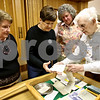 Rob Winner – rwinner@daily-chronicle.com<br /> 150th celebration committee members of the Malta United Methodist Church including Marilyn Berg (from left), Bev Willrett, Pastor Judy Giese and Dorothy Stoddard look at an artifact from a time capsule that was recently opened after 50 years.<br /> 11/09/2009