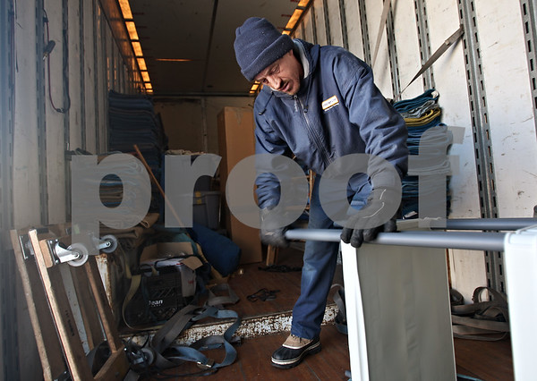 Beck Diefenbach  -  bdiefenbach@daily-chronicle.com<br /> <br /> Dan Coulter, of Browning United, disassembles furniture to be packed into the moving truck full of the Reed family's belongings in Sycamore, Ill., on Tuesday Jan. 20, 2009. The Reed family is moving to Port Richie, Fla.
