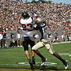 Beck Diefenbach – bdiefenbach@daily-chronicle.com<br /> <br /> Northern Illinois' Reed Cunningham (83) completes a touchdown pass during the first half of the game against Purdue University in West Lafayette, Ind., on Saturday Sept. 19, 2009