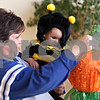 Beck Diefenbach  -  bdiefenbach@daily-chronicle.com<br /> <br /> Vicki Ross, of Sycamore, shows her daughter Abbey, 1,  one of the many piñata for the Halloween party at Bethlehem Lutheran Church in DeKalb, Ill., on Saturday Oct. 24, 2009.