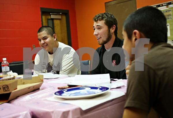 Beck Diefenbach  -  bdiefenbach@daily-chronicle.com<br /> <br /> Left, Justin Roscellie, 17, of DeKalb, listens as Eric Gilbert, center, leads a faith lesson and pizza party with local youths at the Salvation Army in DeKalb, Ill., on September 2, 2009.