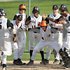 Beck Diefenbach  -  bdiefenbach@daily-chronicle.com<br /> <br /> DeKalb's Steven Karasewski (5) is welcomed at home plate after hitting a grand slam during the bottom of the second inning of the game against Geneva at Dekalb High School in DeKalb, Ill., on Tuesday May 12, 2009.