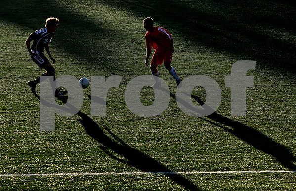 Beck Diefenbach    bdiefenbach@daily-chronicle.com<br /> DeKalb's Keith Hendley (20, right) and Sycamore's Adam Westerby (16) during the first half of the game at the Northern Illinois University Soccer and Track and Field Complex in DeKalb, Ill., on Monday Sept. 5, 2009.