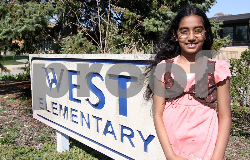 WENDY KEMP/FOR THE DAILY CHRONICLE<br /> Third grade student Mahitha Takkasila stands in front of West Elementary in Sycamore on Friday where she takes part in the after school program.<br /> 4/24/09 Sycamore