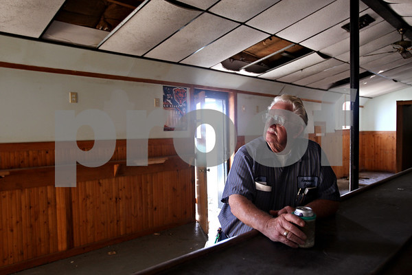 Beck Diefenbach  -  bdiefenbach@daily-chronicle.com<br /> <br /> Ken Hetchler, former mayor of Cortland for 32 years, poses in the bar in which he used to frequent on the corner of IL-38 and Somonauk road outside of Cortland, Ill., on Thursday Sept. 3, 2009. The bar is set to be demolished soon.