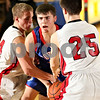 Beck Diefenbach  -  bdiefenbach@daily-chronicle.com<br /> <br /> Hinckley-Big Rock's Ryan Salazar (14) calls for a time out as he is surrounded by Indian Creek's Seth Sanderson (25) and Nathan Peterson (44) during the fourth quarter of the Little 10 consolation game at Somonauk High School in Somonauk, Ill., on Friday Feb. 6, 2009.