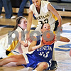 Beck Diefenbach  -  bdiefenbach@daily-chronicle.com<br /> <br /> Sycamore guards Sara Cervenka (25) and Kate Binder (21) watch as Geneva guard Taylor Whitley (23) attempts to get rid of the ball during the third quarter of the game at Sycamore High School in Sycamore, Ill., on Tuesday Feb. 3, 2009. Geneva beat Sycamore 57 to 31.