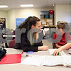 Beck Diefenbach  -  bdiefenbach@daily-chronicle.com<br /> <br /> Assistant teacher Candice Foss, center, helps fourth grader Anthony Kotnik with his homework during an after school program run in conjunction with the YMCA at Little John Elementary School on Tuesday Dec. 15, 2009.