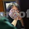 Beck Diefenbach  -  bdiefenbach@daily-chronicle.com<br /> <br /> Pastor Janet Hunt listens during a weekly staff meeting at Salem Lutheran Church in Sycamore, Ill., on Thursday Jan. 8, 2009.