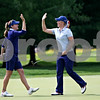 Rob Winner rwinner@shawsuburban.com<br /> Brittany Lang (left) congratulates teammate Brittany Lincicome after winning the sixth hole during the first round of the Solheim Cup on Friday.<br /> 08/21/09