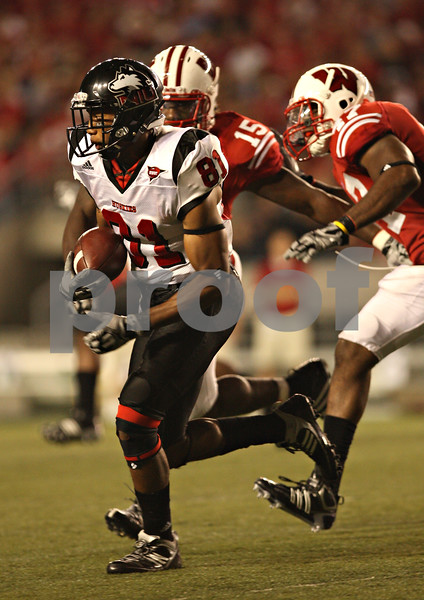 Beck Diefenbach – bdiefenbach@daily-chronicle.com<br /> <br /> Northern Illinois' Nathan Palmer (81) rushes with the ball during the third quarter of the game against University of Wisconsin in Madison, Wisc., on Saturday Sept. 5, 2009. Wisconsin beat Northern Illinois 28 to 20.