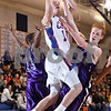 Beck Diefenbach  -  bdiefenbach@daily-chronicle.com<br /> <br /> Genoa-Kingston junior Ethan Menges (10) goes up against Rockford Lutheran guard Eric Widstrom (2) during the second quarter of the game at GK in Genoa, Ill., on Friday Jan. 16, 2009. Lutheran beat GK 46 to 39.