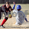Beck Diefenbach  -  bdiefenbach@daily-chronicle.com<br /> <br /> Somonauk Kelsey Castleman (1) slides in safe at second base past Indian Creek's Lauren Anderson during the top of the third inning at Indian Creek High School in Shabbona, Ill., on Friday April 3, 2009.