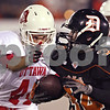 Beck Diefenbach  -  bdiefenbach@daily-chronicle.com<br /> <br /> Ottawa's Derek Martin (44) lines up to tackle DeKalb running back Dalton Watie (34) during the first quarter of the game at Huskie Stadium of Northern Illinois University in DeKalb, Ill., on Friday Aug. 28, 2009.