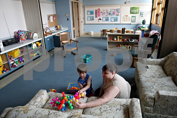 Beck Diefenbach  -  bdiefenbach@daily-chronicle.com<br /> <br /> Dawn George, of DeKalb, plays with her son Aaron, 5, in the nursery of the Bethlehem Evangelical Lutheran Church on Wednesday July 22, 2009. Dawn has been part of this church's community for 25 years and now brings her children.