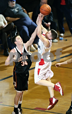 Beck Diefenbach – bdiefenbach@daily-chronicle.com<br /> <br /> DeKalb forward Grant Osen (34) attempts to block a shot by South Elgin forward Jordan Dobler (15) during the third quarter of the Class 4A regional semi-final game at DeKalb High School in DeKalb, Ill., on Wednesday March 4, 2009.