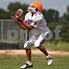 Beck Diefenbach  -  bdiefenbach@daily-chronicle.com<br /> <br /> Genoa-Kingston's Nick Lopez catches a punt during practice at GK High school in Genoa, Ill., on Monday Aug. 17, 2009.